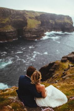 This photo of a couple overlooking their Cliffs of Moher ceremony location is so gorgeous | Image by Magic Wedding Photographer