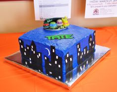 """10"""" square Teenage Mutant Ninja Turtle cake. Buildings and name were cut from Wilton Sugar Sheets"""