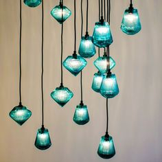 Glass Bead Pendant Light by Tom Dixon is made from thick mouth blown glass & its characterized by hand cut radiating lines around its exterior.