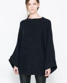 ZARA - WOMAN - PONCHO SWEATER.  women's fashion and street style.  black on black looks.