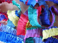 Stitch two crepe paper streamers together for a strong reusable decorative border, garland, etc.  When stitching, push the streamers slightly so they ruffle.