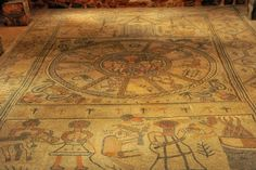 The ancient synagogue of Beit alpha, dated to the Byzantine period, was a 20m x 14M building. It was covered across its entire floor by a magnificent colorful mosaic floor. The mosaic floor, which was very well preserved, includes a Zodiac , Jewish ritual objects and the ark, two inscriptions in Greek and Aramaic, geometric patterns and icons of animals, birds, plants and fruits, and a scene from the Biblical story of the binding of Isaac.