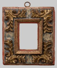 17th century Spanish Baroque pinewood frame with scrolling acanthus leaf corners; parcel-gilt and polychrome; antique hanger; 12.5 x 8.5 cm.
