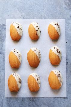 White chocolate dipped orange madeleines with nescafe flavor