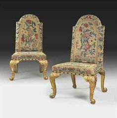 A PAIR OF EARLY GEORGE III GILTWOOD SIDE CHAIRS  THE NEEDLEWORK CIRCA 1715, THE FRAMES CIRCA 1760-65 AND DESIGNED TO ACCOMMODATE THE EARLIER NEEDLEWORK