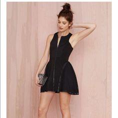 Black dress Black mesh , zip up dress is a x small but stretches Nasty Gal Dresses