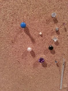 Used lost earrings as tacks in my cork board instead of tossing them! Much prettier and useful.  Side addition of Craft #1.