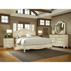French Country Perhaps?  Chateau Sleigh Bed $709.99  Classic sleigh bed design with a flair of its own  Constructed from mahogany solids and select veneers  Refreshing antique white finish  Headboard features carved accents  Available in king or queen sizes