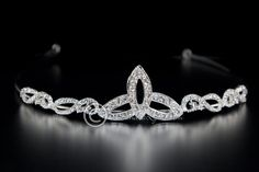 A beautiful, simple trinity Celtic knot tiara adorned with rhinestones.The length of the decoration is 7.5 inches and the height is 1 inch. Click here to see the matching hair pin.                                                                                                                                                     More