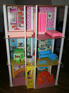 This is neat with the old furniture the way that it was and everything: Vintage 1970's Barbie Townhouse with Lots of Furniture | eBay