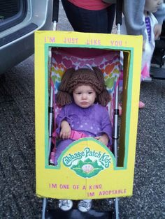 Cabbage Patch Kid (Halloween Costume) Cabbage Patch Baby; using a large cardboard box painted yellow with the logo glued to the front, hat came from the lillie pad on etsy.