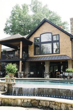 That outdoor living space, the balcony area, the pool that overflows like a waterfall. I want it...