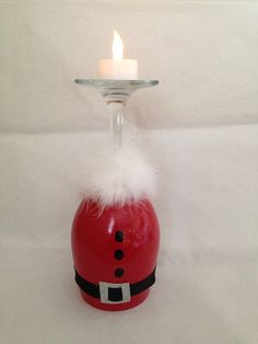 This candle holder is a hand painted wine glass that will add to your Christmas decor. You can use a regular votive candle or a LED battery operated