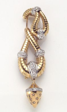 A retro diamond, platinum and eighteen karat gold clip-brooch, French designed with two tubogas patterned, paisley-shaped elements, with platinum accents set with full and single cut diamonds, suspending a cone-shaped diamond-set drop; with French assay marks; estimated total diamond weight: 2.00 carats.
