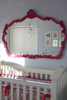 Hot pink mirror like this for a girl.  Lime green for a boy (on a navy wall)
