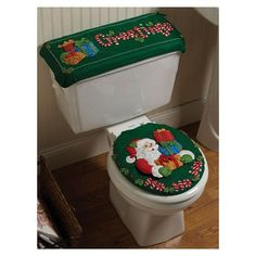 Bucilla ® Seasonal - Felt - Home Decor - Bath Ensemble Kits - Ho Ho Ho Santa. Each home accent kit includes: stamped felt, sequins, embroidery floss, needles and trilingual instructions. If only the kids had better aim this would be cute.