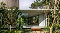 Gui Mattos perches timber-clad box on top of pyramidal ceiling at Brazilian beach house