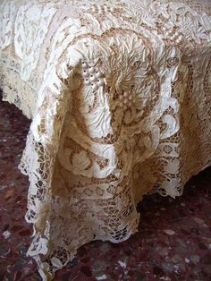 Gorgeous crochet lace antique tablecloth.