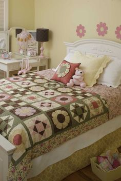 Room by Room Quilts - Learn how to incorporate quilts into all the rooms of your home. Whether it's a throw for the sofa and a coordinating table runner or a full-size quilt with matching pillows for the guest room, there's a design here from Barbara Cherniwchan to add warmth and style. Each main quilt is also shown in an alternate colorway, and some give alternate sizing. The applique templates are in a pattern insert.  10 projects for the beyond-beginner quilter: Family Room--Lily's…