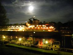 Great Laker coming into Maple St. bridge in Manistee Michigan carefully guided by the Supermoon on Cinco de Mayo