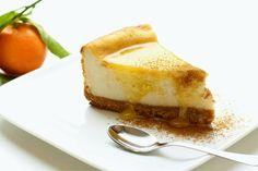 Eggnog cheesecake, orange sauce