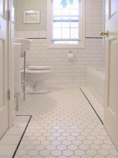 White bathroom floor tiles - wow. We want black grout and the black vanity.