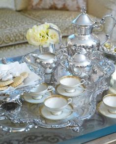 silver tea service with gold rimmed teacups www.tablescapesbydesign.com https://www.facebook.com/pages/Tablescapes-By-Design/129811416695