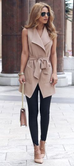 21 black leggings, a long tan vest, tan lace up heels