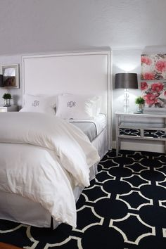 The toned-down color palette is continued in the master bedroom (right) with gray walls, white trim and white bedding.