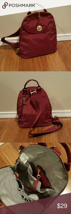 Baggallini Gold Cairo Backpack This stylish burgundy bag has an adjustable zipper strap that converts from a backpack to a sling pack. Removable coin purse and attached key fob. Made of lightweight water resistant nylon.  New but without tags. Baggallini Bags Backpacks