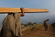 Following the 2015 earthquakes in Nepal  more than 600,000 homes were destroyed,  Damage from the quakes is estimated at around $7 billion.  Nearly one year later, villagers rebuild houses and pathways in the village of Barpak at the quake's epicenter, April 5, 2016.