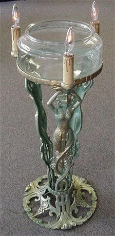 "ART DECO EGYPTIAN REVIVAL FISH BOWL STAND: The Booth Co. of Chicago, rewired for safety and in working order, with glass fish bowl, 35 1/2""h."