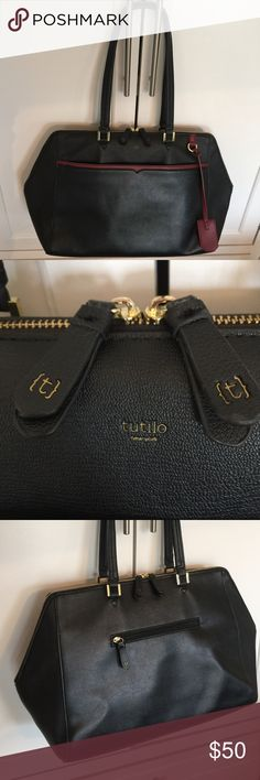 """Tutilo New York briefcase Very stylish black with burgundy trip. Padded laptop area and lots of pockets. Great shape inside and out. Shoulder drop 10.5"""". Very roomy. No stains or scuffs. tutilo Bags Laptop Bags"""