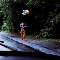 Pennywise-It[1990]. Want to snuggle up and watch this movie. Luv old Stephen King movies