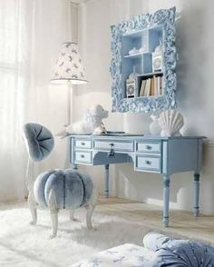 Love the funky blue chair!! The mirror is bananas too!