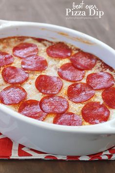 For reals, the best ever pizza dip! A layer of herbed cream cheese, homemade sauce, cheese and then topped with pepperoni. AMAZING!