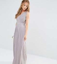 Maxi dress by TFNC, Lined chiffon, V-neckline, Wrap front design, Knife pleated finish, Side-zip closure, Regular fit - true to size, Hand wash, 100% Polyester, Our model wears a UK 8/EU 36/US 4 and is 175cm/5'9 tall, Exclusive to ASOS. London label TFNC is renowned for its standout occasionwear. Step it up in sparkly fabrics, embellished styles and party-prepped bodycon dresses - just don't outshine the bride. Click here for more ASOS Exclusives