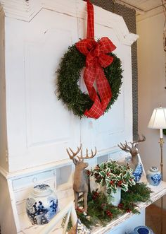 Gorgeous red ribbon around a wreath for your front door from @kelloggfurn