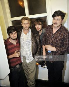 Winston Marshall, Ted Dwane, Ben Lovett and Marcus Mumford of Mumford and Sons are shown backstage at Talking Heads on October 8, 2009 in Southampton, England.