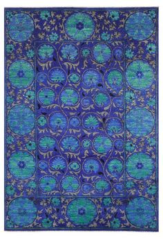 Beautiful blue-green wool carpet hand-knotted in Peshawar.