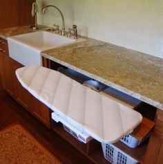 An ironing board that slides out from underneath the counter! Genius!