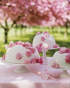 Cherry Blossom Cakes    The traditional princess cake, an old Swedish wedding standby, is normally covered in green marzipan. In our decidedly floral interpretation of the confection, the dome-shaped cake was cloaked in pink fondant and topped it with a smattering of real cherry blossoms, some of which have been coated with sugar.