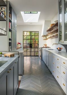 Modern Kitchen 8 Amazing Galley Kitchens—and How to Make The Most of Yours via - These small kitchens are quite impressive with their ingenious design. Read on to see these 8 galley kitchen for yourself. Brooklyn Brownstone, Small Galley Kitchens, Home Kitchens, Galley Style Kitchen, Shaker Style Kitchens, Gray Kitchens, Rustic Kitchens, Planchers En Chevrons, Indoor Outdoor Kitchen