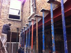 Long steel beam installation for rear, side extension. Temporary works design provided by aleur associates Brief Side Return Extension, Extension Plans, Rear Extension, Victorian Terrace House, Victorian Homes, Kitchen Diner Extension, Steel Beams, Steel House, Construction Design