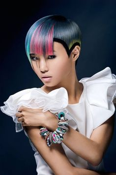 Neon color inspired hair dye. Make your hair light up by using a variety of neon colors for highlights. Start with a platinum base and work through your hair with highlights of light blue pink and yellow.