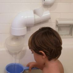 DIY bath toys.  This can keep Logan's attention to the back side of the tub so he won't keep pouring water on the floor!