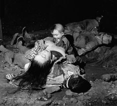 The rape of Nanking or The Nanking Massacre.Sometimes the babies were spared while their mothers were raped and then murdered. Here a baby waits for his dead mother to nurse him.