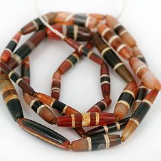 Strand of highly collectible old Chung Dzi Beads (decorated Agate) from Indo Tibet.  ca. 1500+ years old | 31 beads on the strand ~ price on request