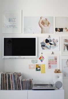 9 Ways to Decorate Around a TV - Tip: run a rope light behind the panel so that it forms a ring of soft light eminating from the sides... this reduces eyestrain when watching at night. And use it with a dimmer switch