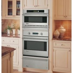GE monogram - oven and microwave with a warming drawer.